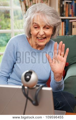 Senior Woman Using Webcam To Talk With Family