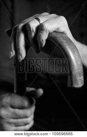 Black And White Image Of Senior Woman Holding Walking Stick