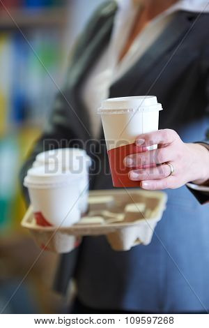 Businesswoman With Takeaway Coffee