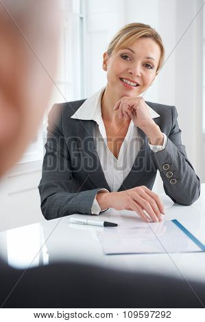 Female Businesswoman Interviewing Male Job Candidate