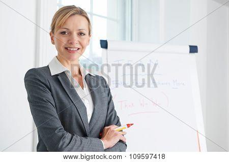 Portrait Of Businesswoman Standing By Flipchart