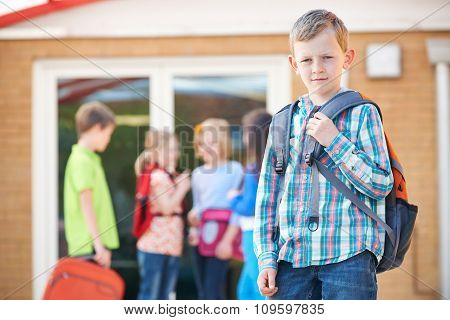 Boy Standing Outside School With Rucksack