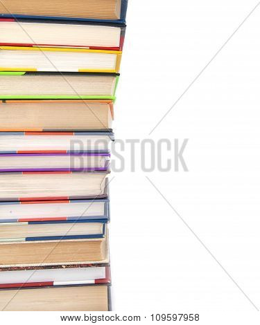 Stack Of Books On A White Background On The Left..