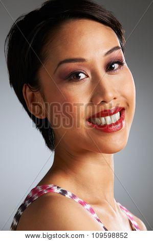 Studio Portrait Of Happy And Beautiful Woman