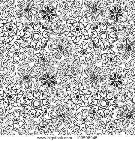 Seamless pattern in Indian style.  Ethnic ornament with flowers and paisleys in black and white colo