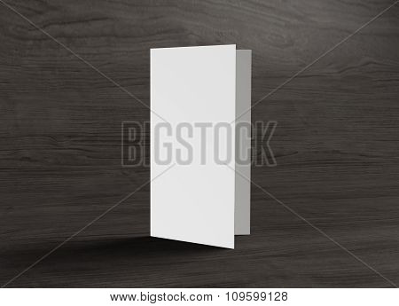Leaflet Front Cover Stand On Wood Background