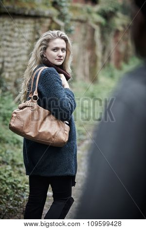 Young Woman Feeling Threatened As She Walks Home