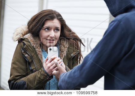 Teenage Girl Being Mugged For Mobile Phone