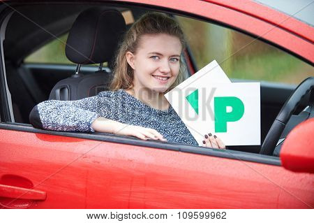 Teenage Girl Recently Passed Driving Test Holding P Plates