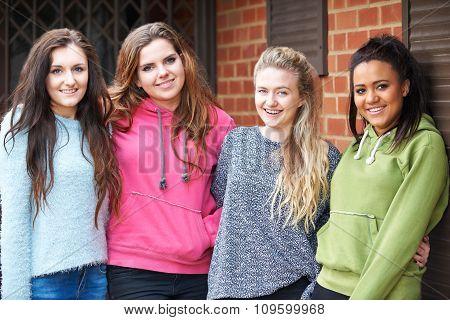 Group Of Teenage Female Friends In Urban Setting