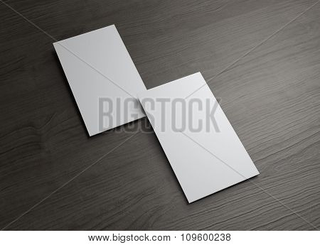 Vertical Business Cards Overlap On Wood Table