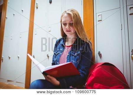 Focused student sitting and studying on notebook at the university
