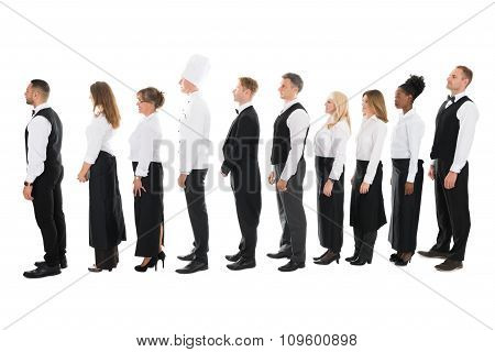 Side View Of Restaurant Staff Standing In Line