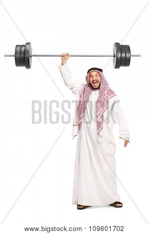Full length portrait of a very strong young Arab lifting a heavy barbell with just one hand isolated on white background