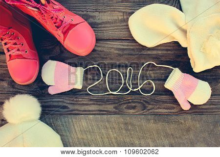 Children's winter clothes: warm scarf, mittens, boots. 2016 year written laces of children's mittens