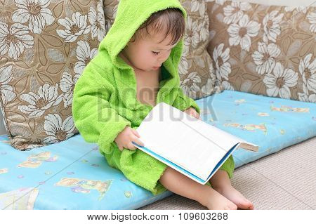 Baby In Bathrobe Reading Book