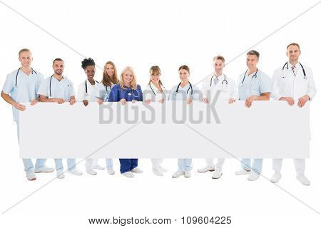 Confident Multiethnic Medical Team Holding Blank Billboard