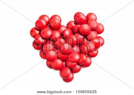 Heart Shape With Red Milk Chocolate Candies On White Background