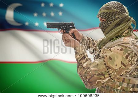 Male In Muslim Keffiyeh With Gun In Hand And National Flag On Background - Uzbekistan