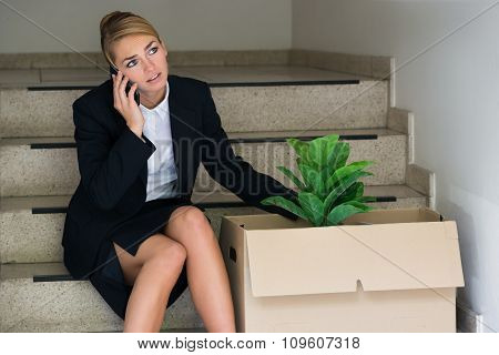 Fired Businesswoman Talking On Mobile Phone