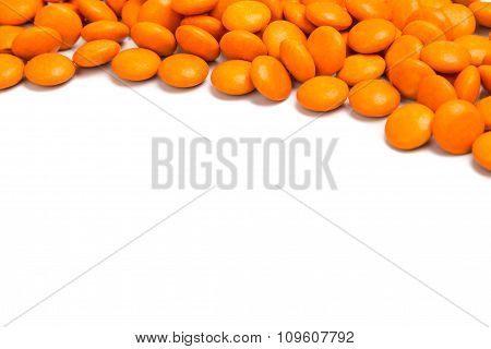 Top Right Frame Of Orange Chocolate Candy On White Background