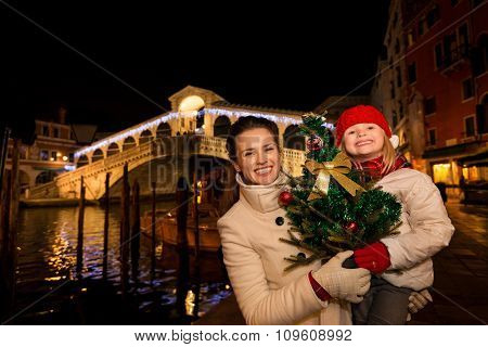 Mother And Daughter With Christmas Tree Near Rialto Bridge