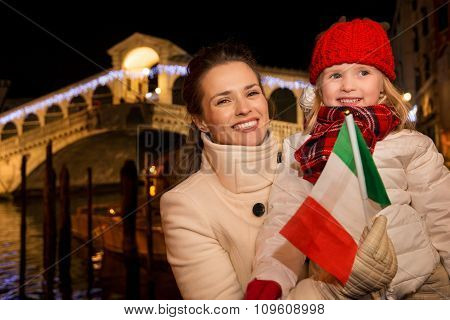 Mother And Daughter With Italian Flag In Christmas Venice, Italy