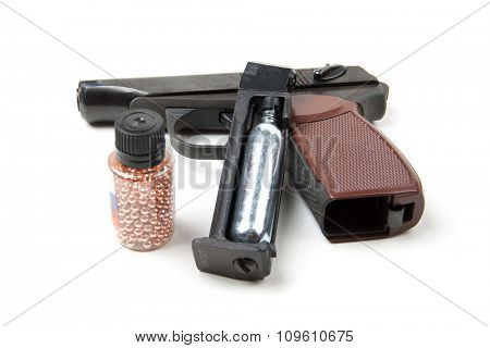 Isolated disassembled gun and hands on white background