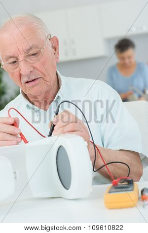 elderly man fixing