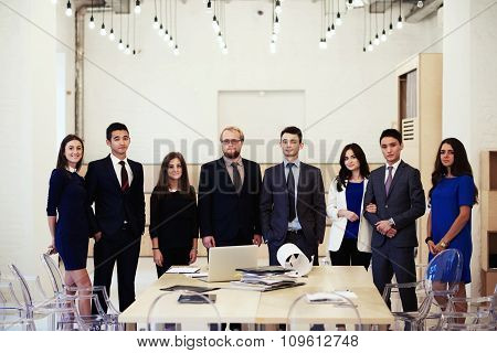 Successful professional workers in corporate clothes