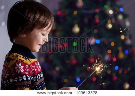 Beautiful Little Child Holding Burning Sparkler On New Year's Eve