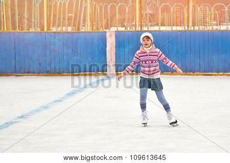 girl ice skating on rink