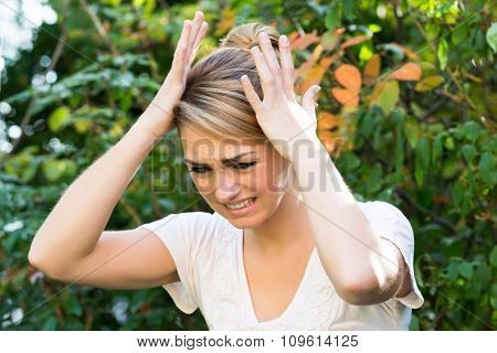 Woman With Hands On Head Against Plants