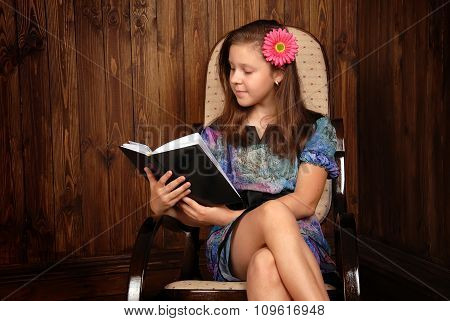 Girl in a chair with the book