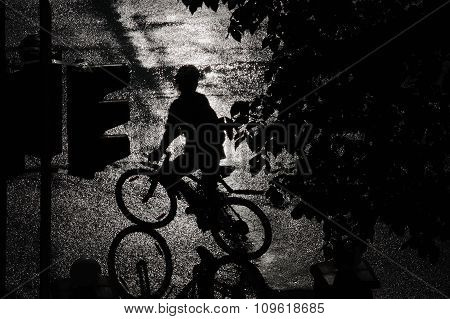 Silhouette of a cyclist at a crossroads