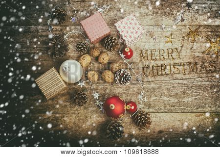 Festive Gifts with Boxes, Baubles, Pine Cones, Walnuts on Wooden Background.