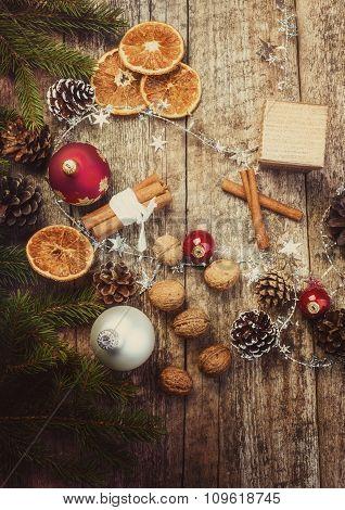 Christmas Decoration. Dried Oranges, Cinnamon Sticks, Walnuts, Baubles, Pine Cones.