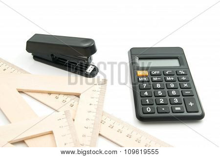 Stapler, Wooden Ruler And Calculator