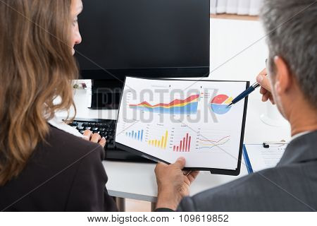 Two Businesspeople Discussing Graph