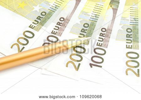 Euros Banknotes And Pen On White