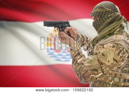 Male In Muslim Keffiyeh With Gun In Hand And National Flag On Background - French Polynesia