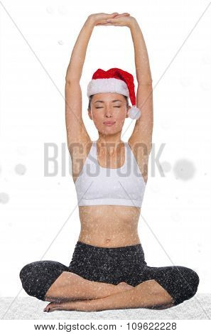 Relaxed Asian Woman In Christmas Hat With Snow Practicing Yoga