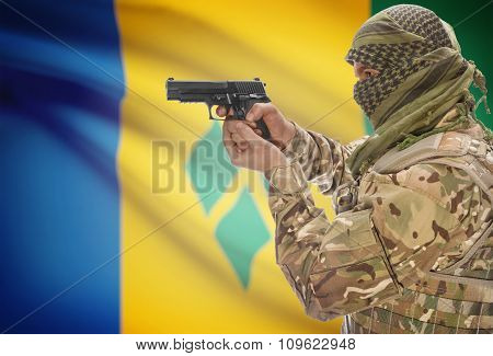 Male In With Gun In Hand And National Flag On Background - Saint Vincent And The Gre