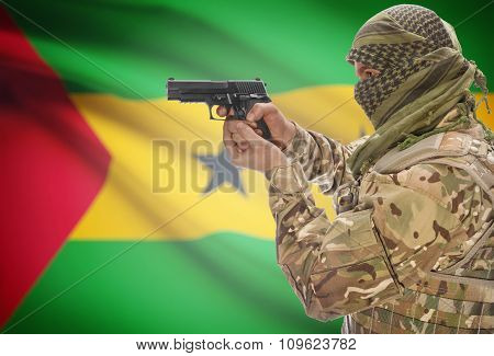 Male In Muslim Keffiyeh With Gun In Hand And National Flag On Background - Sao Tome And Principe