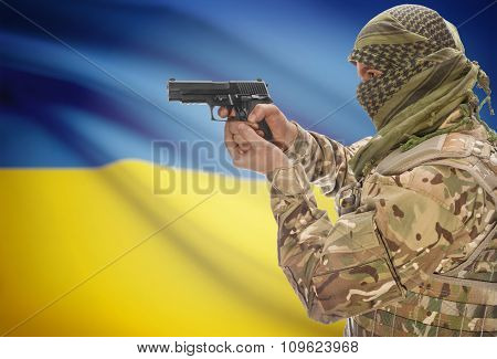 Male In Muslim Keffiyeh With Gun In Hand And National Flag On Background - Ukraine