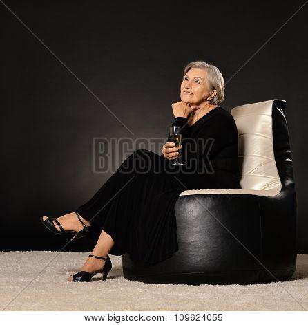 Elegant woman drinking