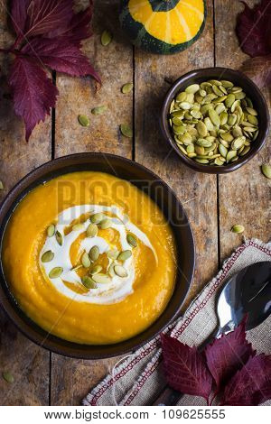 Pumpkin Soup With Pumpkin Seeds  In Bowl