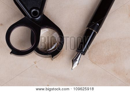 Magnifying Glass And Fountain Pen
