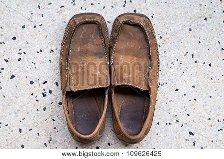 Old Leather Shoes On Terrazzo Floor