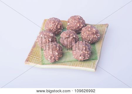Chocolate Ball Or Chocolate Bonbon On A Background.